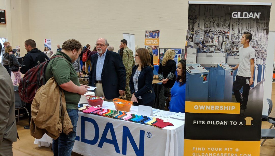 Student learns about career options and opportunities at Gildan during 2019 Career Expo at Davie County High School