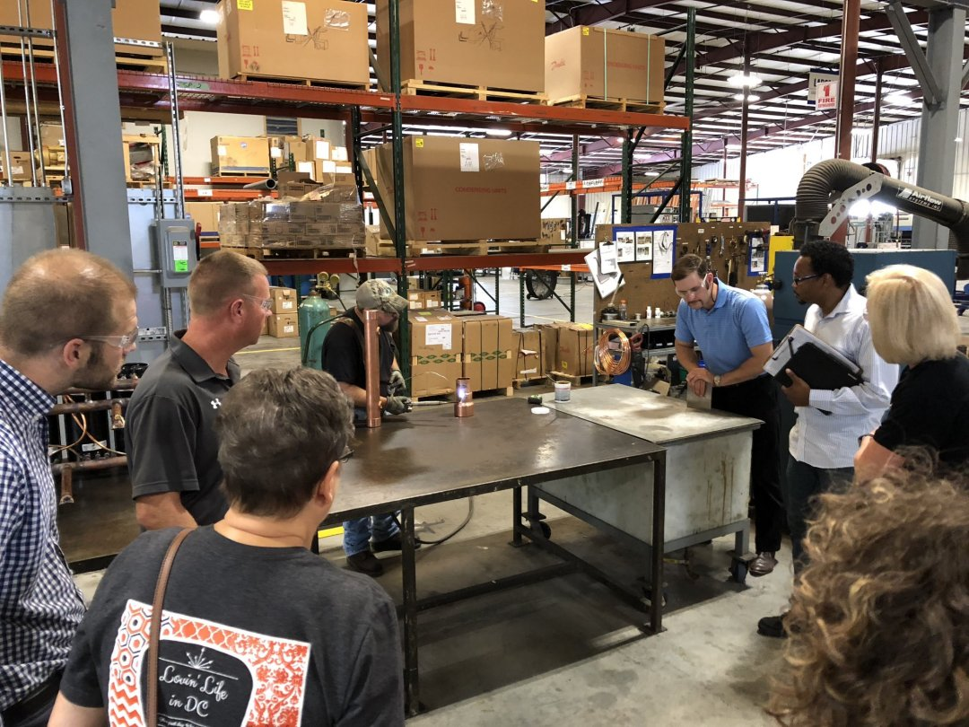 Teachers learn about the jobs and skill requirements at Pro Refrigeration during teacher externship presentation.