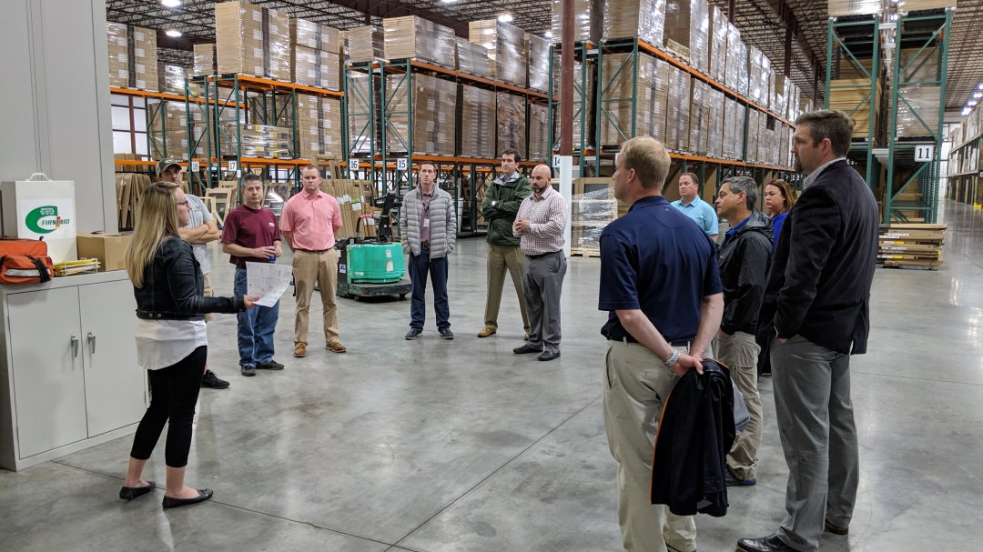 Community and business leaders from Mocksville and Davie County tour new Comfort Bilt distribution center at Southpoint Business Park in Mocksville.
