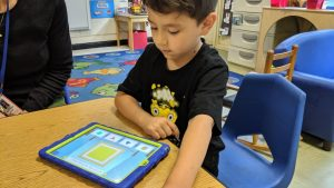 06 - Central Davie Preschool student Alan Reyes works with Cognitive ToyBox