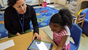 Josey Redinger, NC Pre-K teacher at Central Davie Preschool watches as student Zakoiya Summers works with Cognitive ToyBox