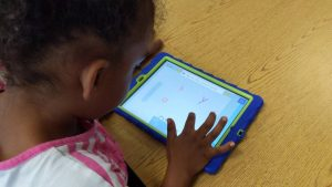Central Davie Preschool student Zakoiya Summers works on the Cognitive ToyBox