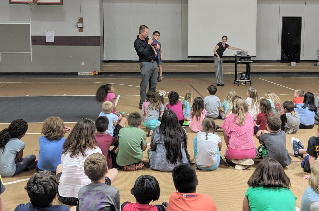 Camp Director, Jeremy Brooks, used first-grader, Noah Penland, as a ventriloquist puppet to explain what to wear at water day.