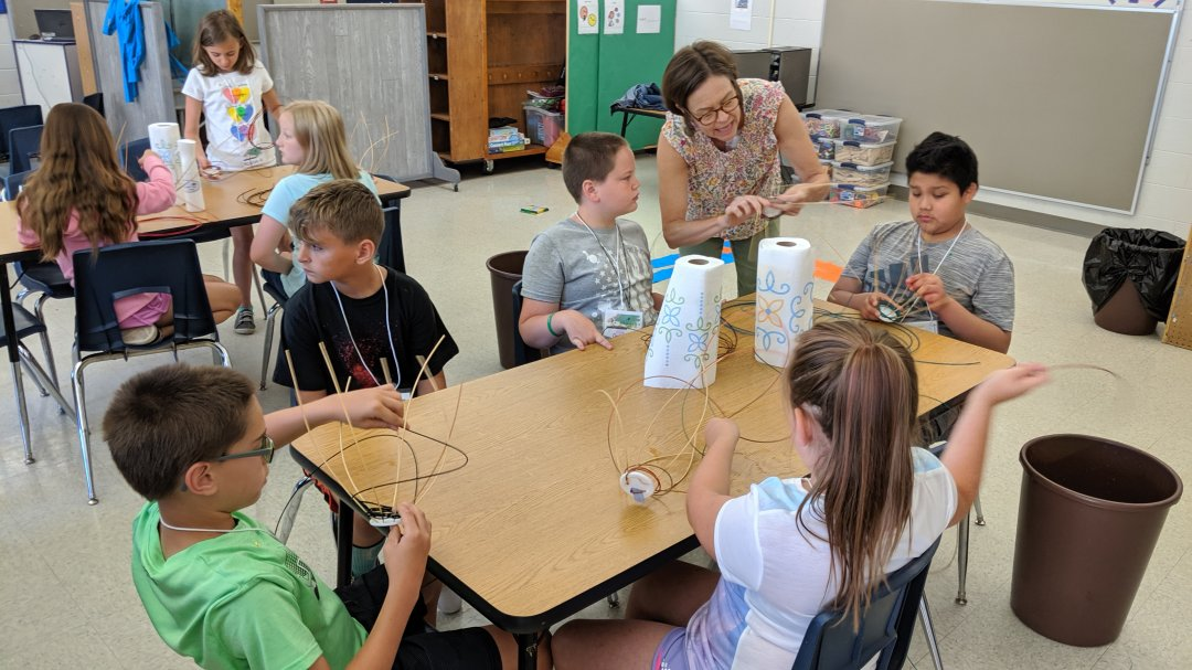 Julie Marklin works with students during an art session