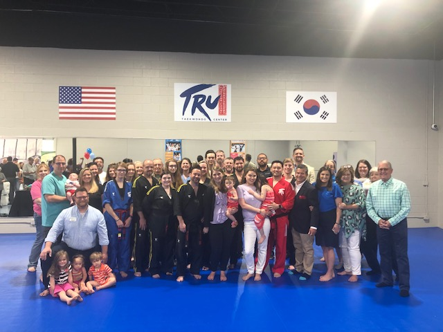 A crowd turns out for the Davie Chamber ribbon cutting ceremony for Tru Taekwondo in Bermuda Run