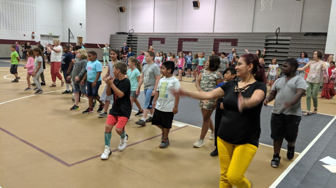 Teachers engage with students during the combined camp opening session.