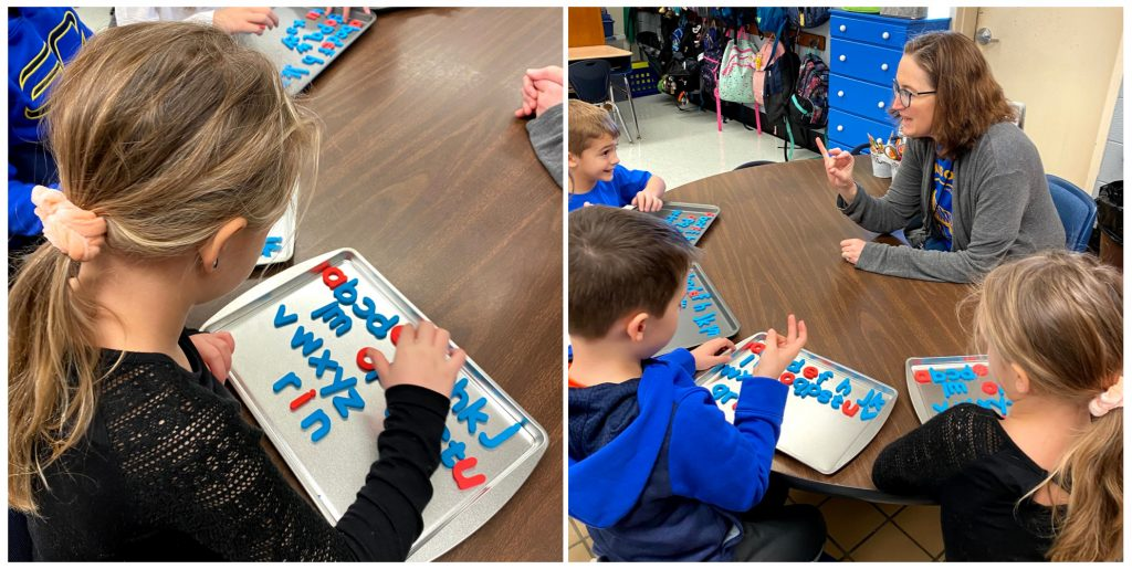 Pinebrook first-graders (L-R) Kolyns Waszczeniuk, Seger Holt, Emma Swofford, and Nicolas Poplawski, tap out word sounds with their teacher, Sandy Hendrix.