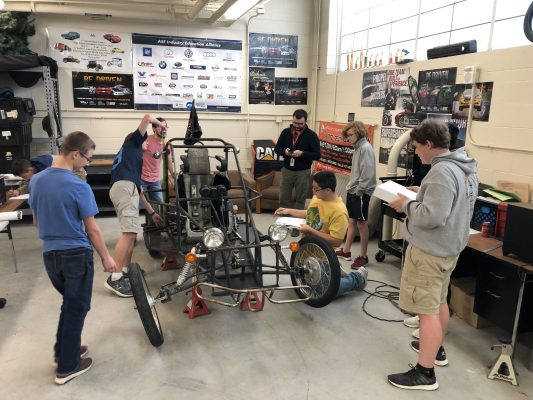 "Members of the ""Zip Ties"" engineering group take measurements of the kart to be transferred to a digital model so that soft changes can be made before physical ones. This is in the CTE Building at DCHS."