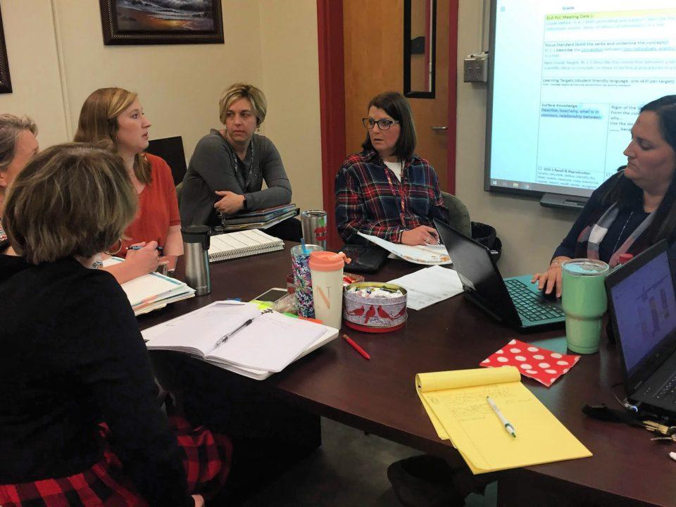 First-grade teachers at William R. Davie clarify standards during a PLC meeting. From front left: Nancy Scoggin, Bobbi Marroquin, Jennie Hughett, Bridgett Bailey, Kristin Alexander, Sunni Collins.