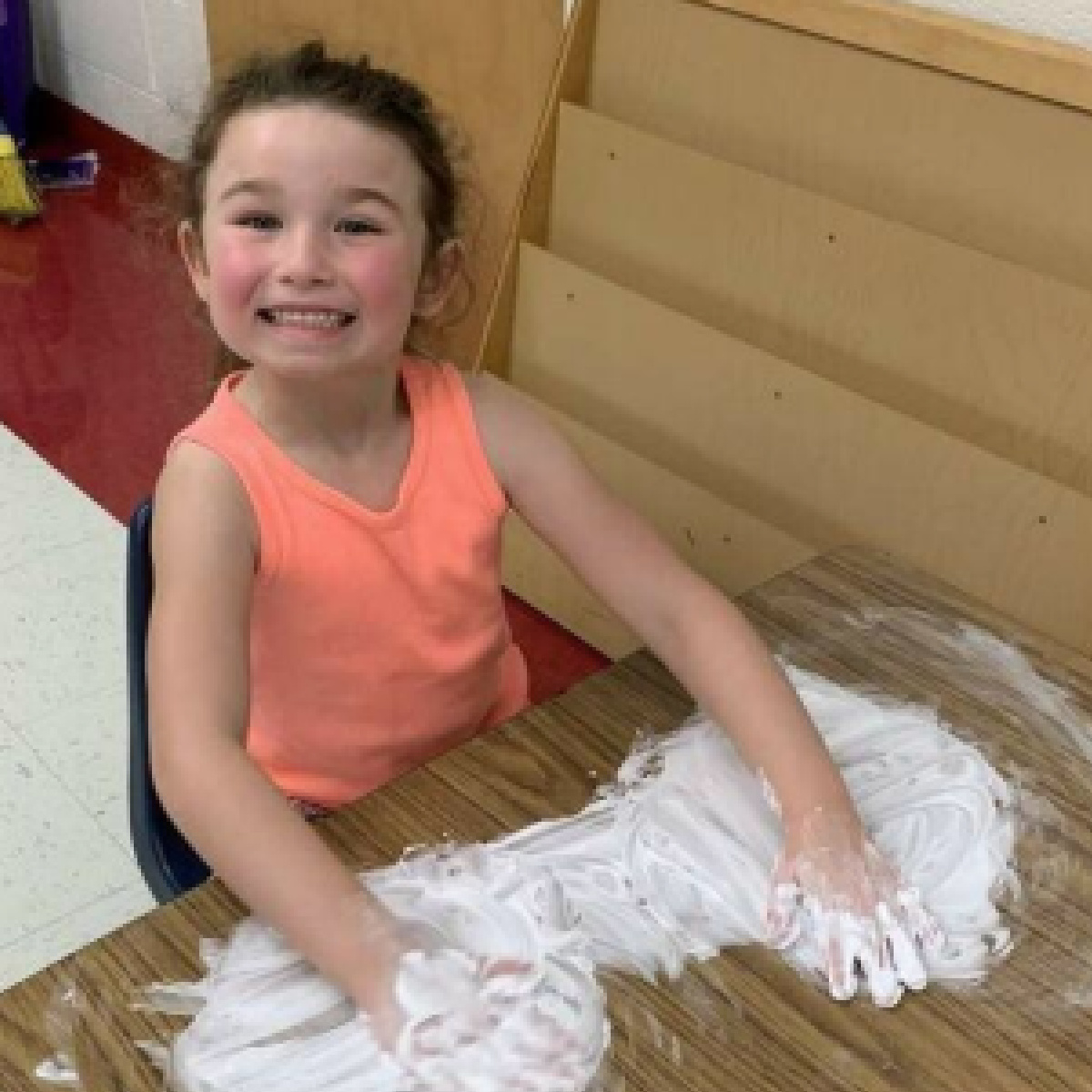 Caylee Anderson's big smile shows how much fun she is having at kinder camp at Cooleemee Elementary