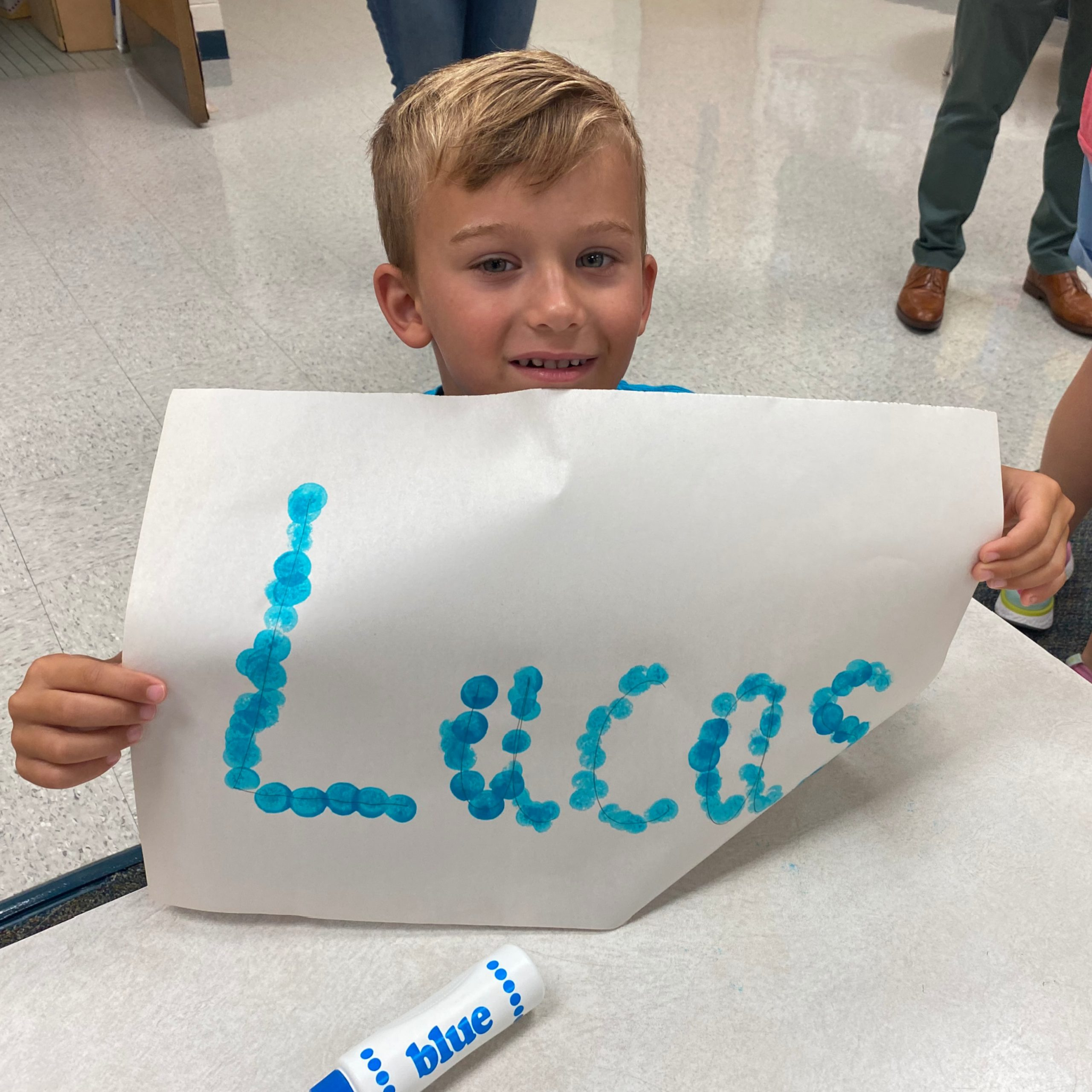 Lucas Pasquet practices his name during kinder camp at Pinebrook Elementary