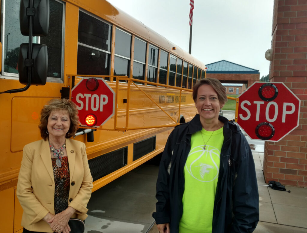Senator Joyce Krawiec checks out a bus in Yadkin County with an Extended Stop Arm. The extension dramatically decreases the number of vehicles illegally passing stopped school buses.