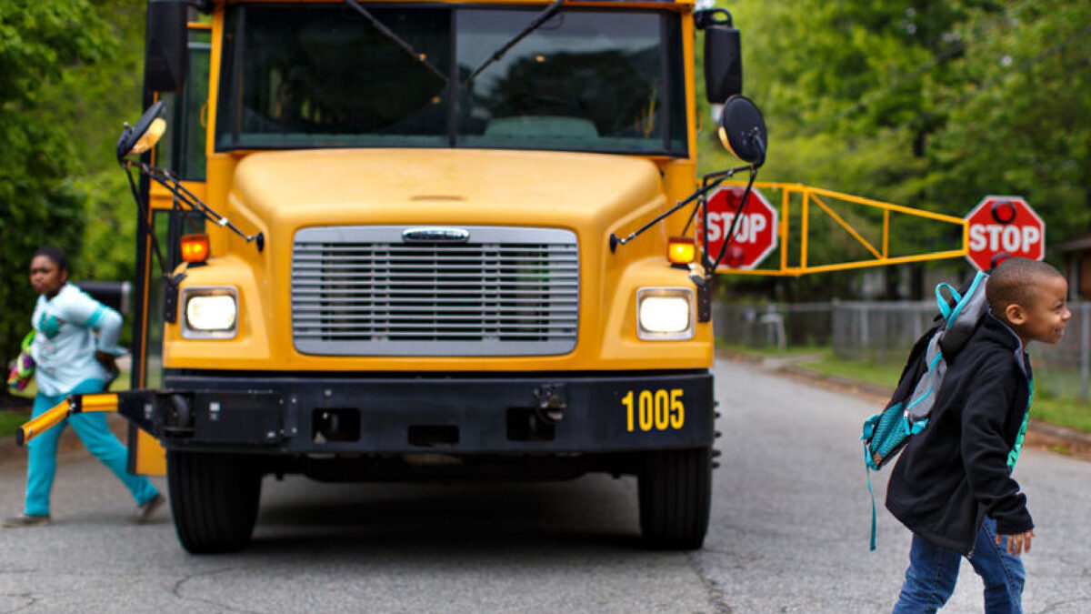 Bus Safety Solutions Extended arm prevents cars from passing schoool busses illegaly