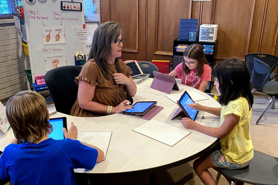 Kerry Blackwelder practices word decoding with (L-R) Gunner Connell, Amber Brown, and Kaylee Spade