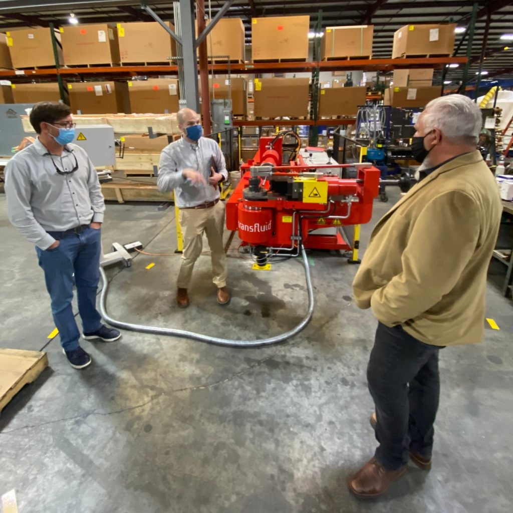 Jon Riesenweber shows Brett Cocking (L) and Sam Wilson (R) the new Mandrel Tube Bender, part of Pro Refrigeration's equipment upgrades at its manufacturing facility in Mocksville