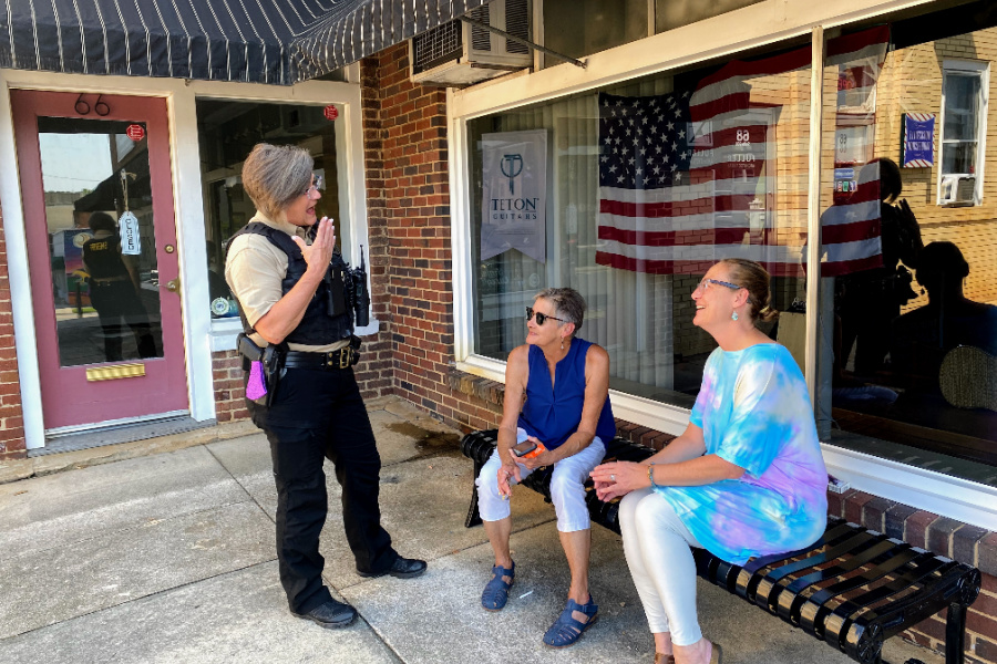 (L to R) Officer Karen Austin checks in with Community Development Coordinator Tami Langdon, and Joy Underwood, owner of Southern Mood in Mocksville NC